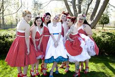 Loving the colored crinoline - Robin & Ken's retro pin-ups and greasers rockabilly wedding   Offbeat Bride