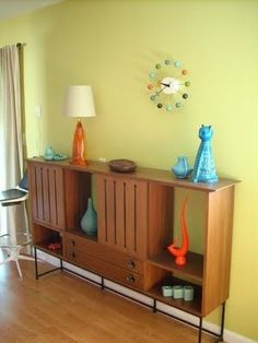 Very close to M's green. Midcentury furniture and colorful accessories.