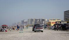 Cars along the sand and ocean in Daytona Beach.