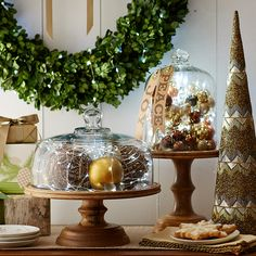 Display a sweet homage to Christmas treats with Decorative Spheres and Pier 1 Glimmer Strings™ under cake domes.