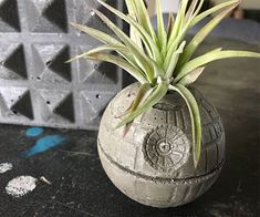 Keep your plants blooming in this extra terrestrial battle station Star Wars Death Star Planter from the Galactic Empire. This planter is something to have for Star Wars enthusiasts. The Death Star Pl