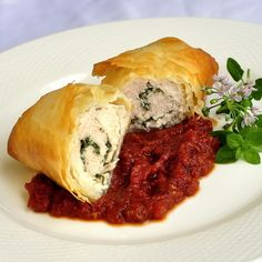 Phyllo Chicken & Herb Roulade with Roasted Tomato Jam - if you are hosting a dinner party, this is one of my go-to recipes for making it a delicious success. It can be prepared well in advance and popped into the oven while you enjoy pre-dinner cocktails and hors d'ouevres. Simple but impressive, just what a dinner party dish should be.