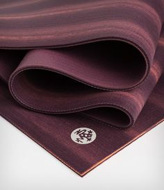 A luxuriously dense and spacious yoga mat for unmatched comfort and cushioning. Designed for performance and durability, the PRO will never wear out, guaranteed.   Dynamic is a limited edition, marbled plumb and marigold colored PRO. Standard length: 7.5 lbs; 71