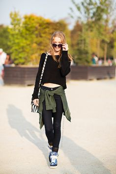 #HollieMaySaker #offduty in Paris wearing an all black outfit with a green jacket.