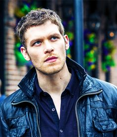 (FC Joseph Morgan) (English accent) Hello ladies and gentleman. The names Klaus and unlike the Angels out there, I happen to be an archdemon. One of the few who joined Lucifer during the rebellion. I suggest if you see me around, you better run for your life. I'm neither kind nor caring and I'm cold hearted. I won't hesitate to kill you if you get on my bad side and I can be rather sarcastic and manipulative. Anyway. See you around.