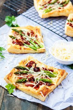 Trick everyone into thinking you spent a ton of time in the kitchen with these simple yet gourmet-seeming Asparagus Prosciutto Puff Pastry Pizzas. This pizza recipe works great for a lunch or outdoor brunch or as a dinner party appetizer!