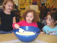 Thanksgiving Science Lesson: Kindergarteners started out by tasting buttermilk. They then compared and contrasted the different states of matter by making homemade butter. Finally, they made wonderful homemade muffins to go with their fresh butter.