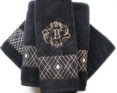 August Ave towels give your bathroom an instant makeover!!! Contact us for Custom Orders. This listing is for a custom Black towel decorated with the Black and Gold Diamond fabric, then monogrammed in Gold with the letter of your choice. **Premium 100% Cotton Towel **Thick and Plush **Designer Fabrics- Gold Sparkle **Quality Construction **Washer and Dryer Safe **Instant bathroom Makeover  These are sold individually. Pick your towel size in the drop down box- Washcloth- 12x12 Hand Towel…