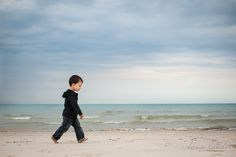 Sweet photograph of a baby boy walking on the beach.  Beautiful use of negative space. | Dana Lauder