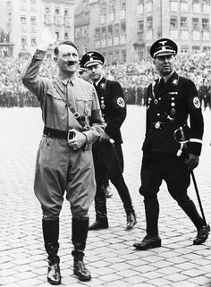 Adolf Hitler saluting at Nazi Party Day, Nuremberg, Germany. 1937.