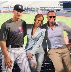 With her man:Jennifer Lopez went to Yankee Stadium in the Bronx with Alex Rodriguez on Friday; here they are seen with  Yankee Aaron Judge