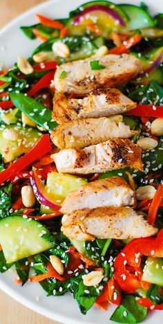 Crunchy Asian Salad with spinach, cucumbers, red bell pepper, carrots, sugar snap peas  – all tossed in a delicious, homemade peanut dressing, topped with grilled chicken, toasted peanuts and sesame seeds. Healthy, gluten free recipe! chinese detox soup