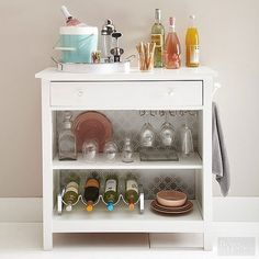 An ordinary wooden nightstand can become a smart beverage station with a little bit of sanding and a coat of white interior semigloss latex paint. For durability, seal the top with a water-base acrylic sealer. Bold wallpaper adhered to the back and new hardware add oomph. Make your bar cart mobile by adding casters to the legs./