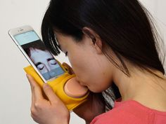 Kissenger Mobile Remote Kiss Smartphone Case Let's You Smooch Your Loved Ones From Afar  #creepy #kiss #love #mobile #sex #smartphone #strange #travel Let's review for a moment.  The socially networked IZIVIBE and its companion app realized humanity's boldest ambitions of fusing a vibrator with a s...