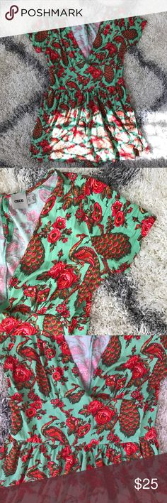 ASOS Peacock Print Romper CUTE flows teal Romper with peacock print! Deep V (can wear with a bra!) Jersey Fabric. Short hem on shorts, hits mid to high thigh. Key hole with button closer on top. True to size! Worn once and in great condition! Offers welcome! ASOS Pants Jumpsuits & Rompers