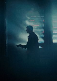 Blade Runner. Love this shot due to it perfectly showing the fear in Deckard and showing the grim look of the whole film.