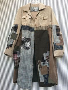 """Upcycled Corduroy Spring Jacket Longer Trench Coat Style Open front Lots of plaid patchwork Appliqué I added a Big side Pocket Corduroy is a soft light weight Reconstructed arms for an easier comfortable fit through the elbows. Measured with garment laying flat 21"""" across armpit to"""