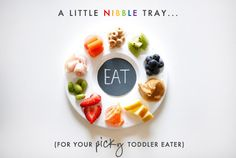 Nibble tray for kids. -- isn't this kind of automatic? every time i've made food for kids i nanny, i'd just make small piles of tons of different small foods, because this is naturally just how toddlers/young kids like to eat. all that said, these photos are very cute.