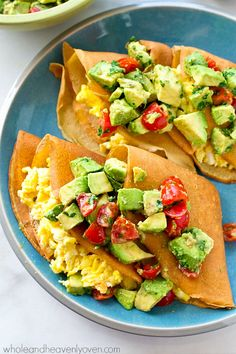 Classic crepes get a savory makeover when they're filled with scrambled eggs and covered in an amazing avocado pico de gallo! --- The ultimate Cinco de Mayo breakfast!