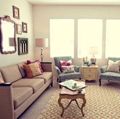 I especially love the two comfy armchairs and small table between them. Overall, a bright, inviting room.