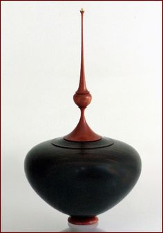 "by Cindy Drozda Ebony and (Pink) Ivory, 2010 Macassar Ebony, Pin Ivory Wood   2mm Ruby, 14K Gold  10""H x 5.5"" dia"