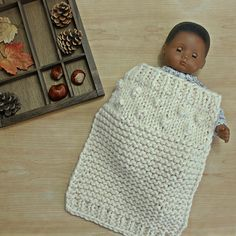 For the sweetest dolls, a teeny version of my hand knit Bobble baby blanket! Sized approx 30cm x 35cm it fits most dolly cradles or beds. Turnaround time is about 2 weeks or so. The yarn is 50% acrylic and 50% wool and very soft. Have a custom color in mind? Just let me know and I will