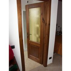 Porta interna in legno rustico e vetro