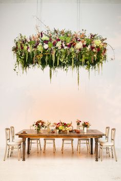 Wow! A spectacular floral installment by Fleur - http://fleurchicago.com/ on http://www.StyleMePretty.com/midwest-weddings/2014/03/31/garden-loft-wedding-in-chicago-illinois/ Becca Heuer Photography http://photography.beccaheuer.com/love.html #smp