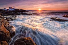 Nubble Lighthouse with Crashing Waves at Sunrise – York, ME by Jeff Sinon