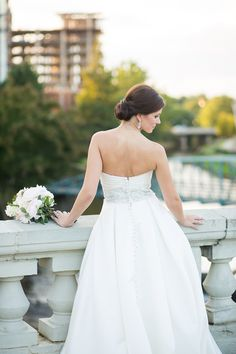 Classic satin wedding dress with buttons down the back