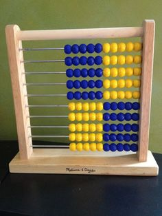 Convert a Melissa & Doug rainbow abacus into a RightStart abacus with just some spray paint.
