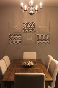 Wall art idea for dining room: Material covered canvas; some covered with burlap with words inscribed on them.