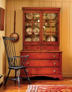 An 1840 pine step-back cupboard filled with antique Quimper plates. - Country Living  I love the cupboard and the painted paneling--with so much outdated paneling in houses around here, this is a good reminder that I can update it with colors beyond white.