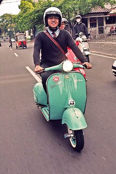 Vespa *scooterun around the city of Jakarta, Indonesia*