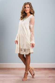 """The Life You Dream Of Dress, Cream""Description   Attributes   Model Specs Description This dress is 100% precious!! The sheer top layer is covered in sporadic crochet embroidery which gives this dress such a light and airy feel #newarrvivals #shopthemint"