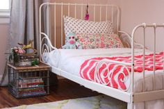 wrought iron bed, old wire basket with wood top