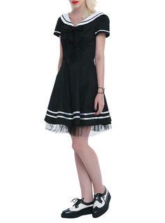 "Black mini swing dress with a white sailor collar, white striped detailing and black tulle trim. Side zipper closure.<ul><li> 31"" long from shoulder</li><li>97% cotton; 3% spandex</li><li>Wash cold; hang dry</li><li>Imported</li><li>Listd in junior sizes</li></ul>"