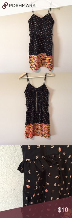 Figure 8 Dress with Pockets Fun little dress with frillies on the pockets. Adjustable straps. Zippered back. •No returns, no trades •10% discount on 3+ items Xhilaration Dresses