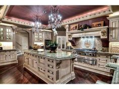 Super elegant kitchen with marble counter tops and high end cabinetry.