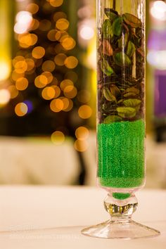 Decoration - Pinned by Mak Khalaf Dry leaves and green sand decoration christmas tree with bokeh lights in background. Abstract abstractartbackgroundbeautifulbokehdecorationdrygreenleavesplant by jernej72