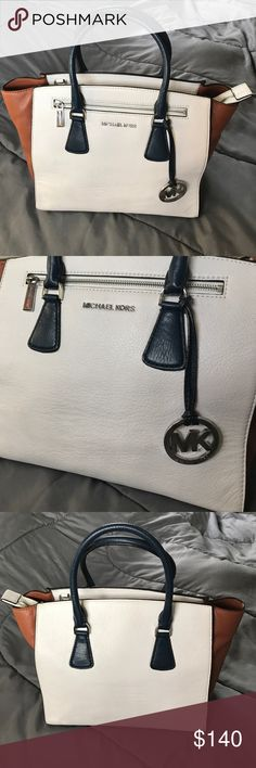 """Michael Kors Purse This Authentic & Gorgeous MK Handbag is unique!! White, Navy Blue, Brown & Chrome. It is gently used & extremely clean!! Doesn't come w/ the shoulder strap. Make it yours today before somebody else does!!  measures: 10"""" top to bottom. 13"""" left to right. 8"""" side to side. Plenty of room!!!!  Michael Kors Bags"""