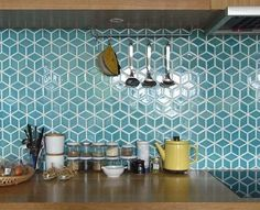 f you want to bring in a splash of patterns and colours to your kitchen, but are afraid that they will seem overboard, then this tile backsplash trend is just for you. Go for geometrical patterns, monochrome colours, stripes or colour blocks! Anything that you feel defines you and your kitchen mood!
