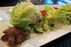 The Wedge Salad at T-Bones Steak & Seafood in St. Clair Shores features a trio of lettuce hearts plated with cherry tomatoes, cucumbers, Gorgonzola dressing and bacon-onion marmalade.