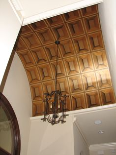 A Trompe l'eoil paneled arched entry ceiling using Modern Masters golds and bronzes. Artistry by Kathy Beck of Just Faux Fun.