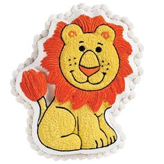 Friendly Lion Cake  - Use different piping techniques and colored icings to realistically detail a Friendly Lion Pan cake. Further define features and limbs with outlines created with our No. 3 Round Decorating Tip and black icing.