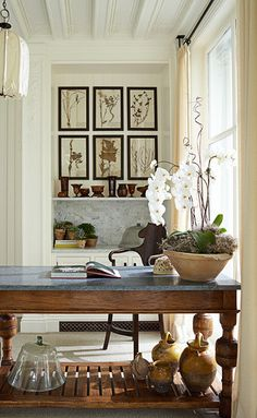 Lots of inspiration for the home here, framed prints, florals, desk, great light from large windows.