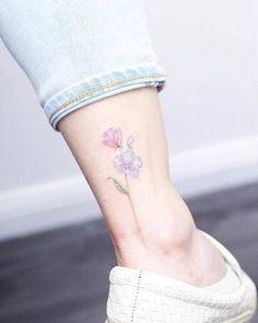 Delicate florals tattoo on ankle. Tattoo artist: Mini Lau