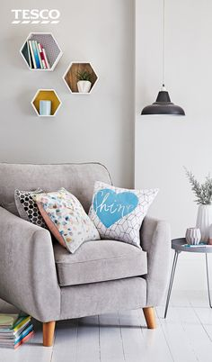 Sit back and admire your very own gallery wall with these hexagonal shelves. Mix it up with books, plants and accessories to finish the look. | Tesco