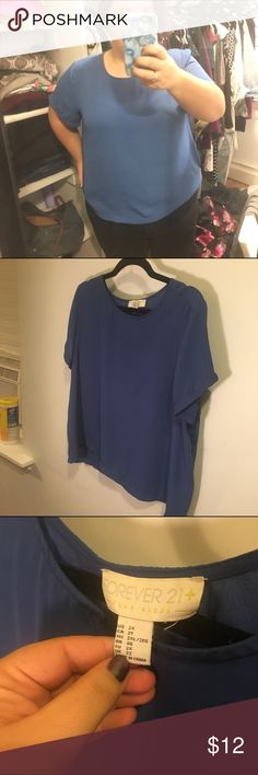 Silky T-Shirt/Shell Blouse This is a vibrant blue silky (not silk) blouse cut like a teeshirt. It pairs really well with work wear or jeans and can be dressed up or down. Forever 21 Tops Blouses