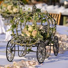 A tabletop Cinderella's Coach filled with floral is a sweet nod to the classic fairy tale